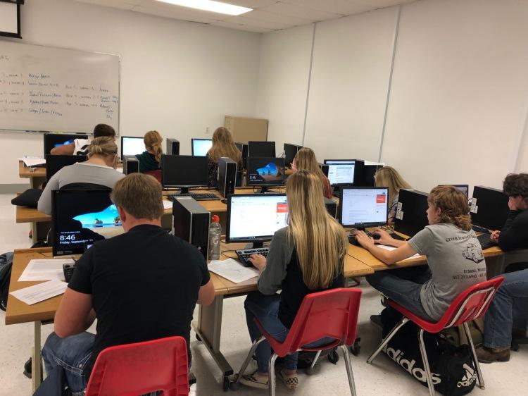 Students work in Writer's Workshop to write ekphrastic poetry.