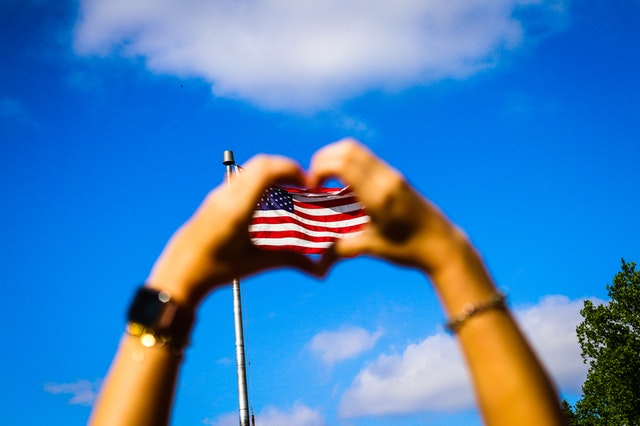 Heart hands reveal the American flag. Veterans Day poems honor our country.