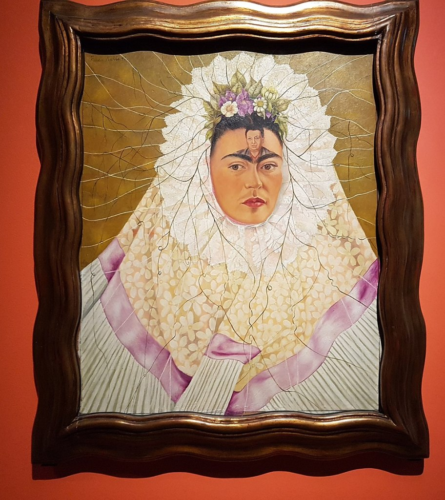 My students will write a first draft of an ekphrastic based on this painting by Frida Kahlo.