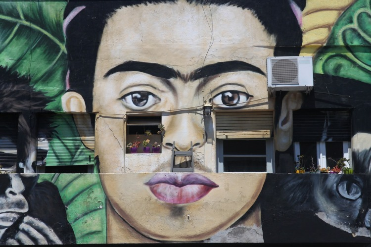 A photo of a mural of Frida Kahlo illustrates this post about ekphrastic poems, a type of poetry for high school students.