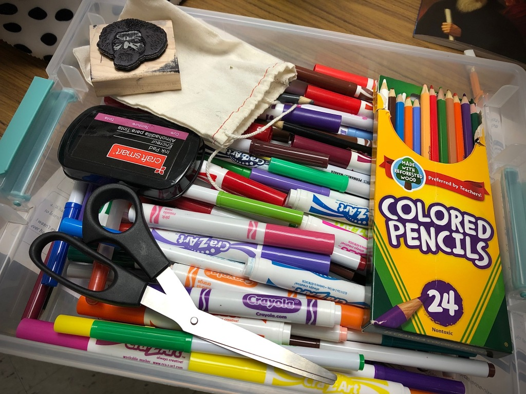 I provided this box of crayons, markers, and even a Frederick Douglass stamp for students to use to make their one-pagers.