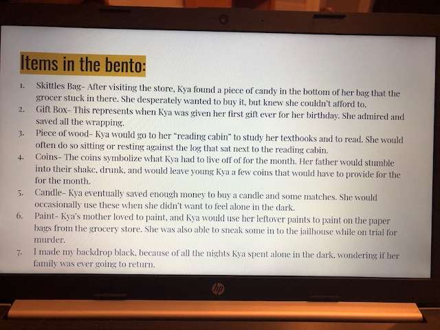 A photo of a Google Slide that contains an explanation of the objects in the student's book bento.