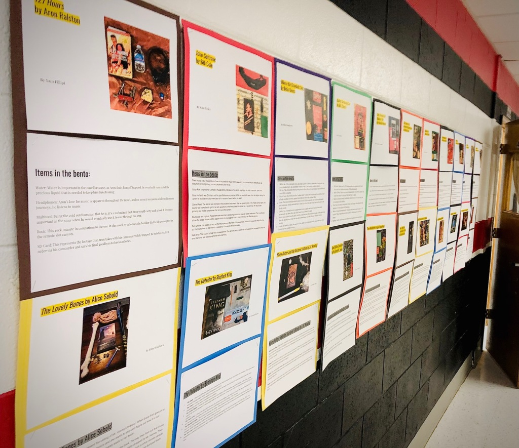 A wall display of book bentos made by high school students.