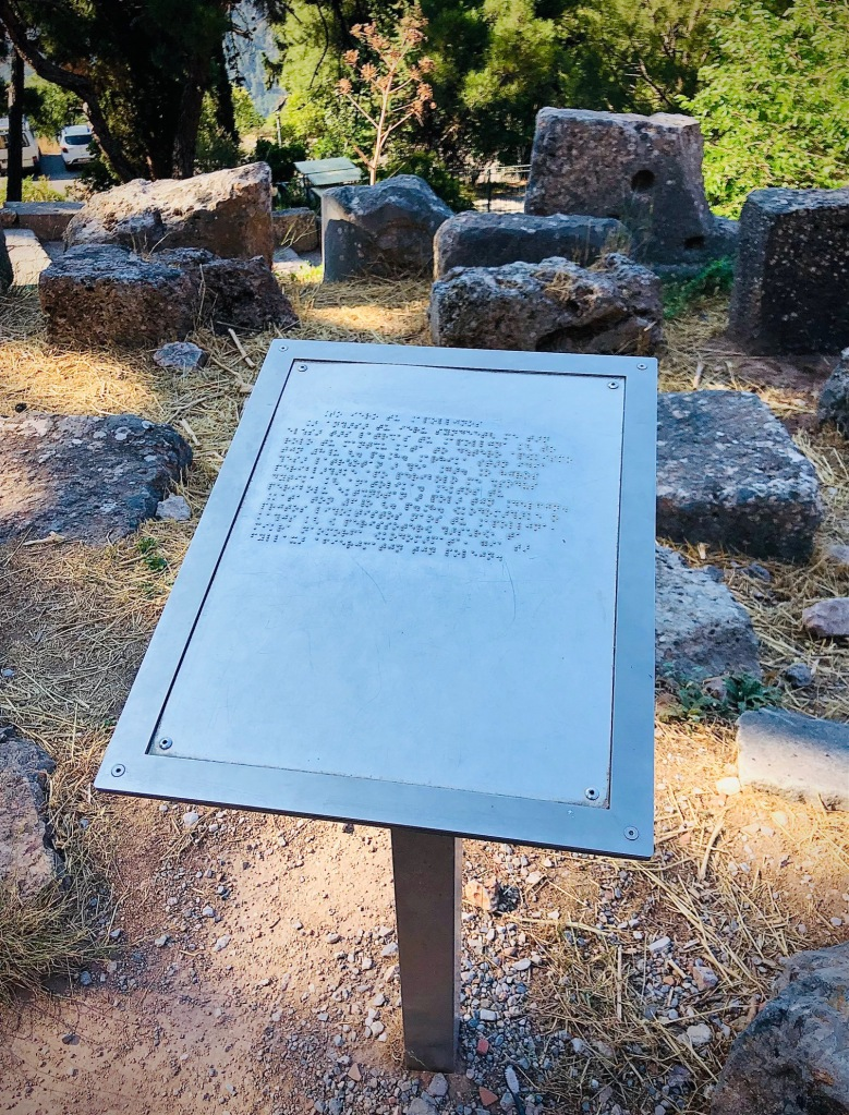 A historical marker in Braille in Delphi, Greece.