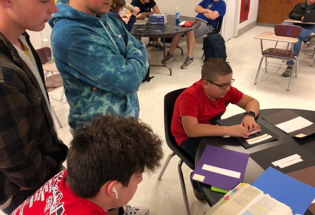 Students read Braille text of John Milton's Paradise Lost.
