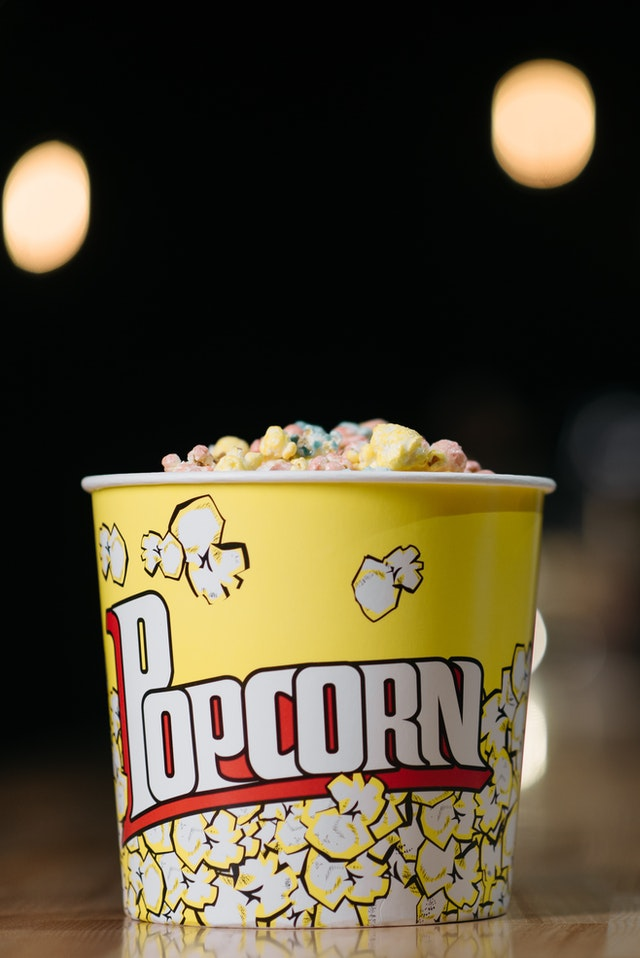 A bucket of movie popcorn.