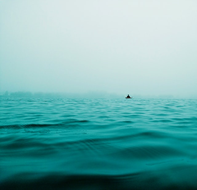 A lone boat on open water illustrates the exile of The Wanderer poem